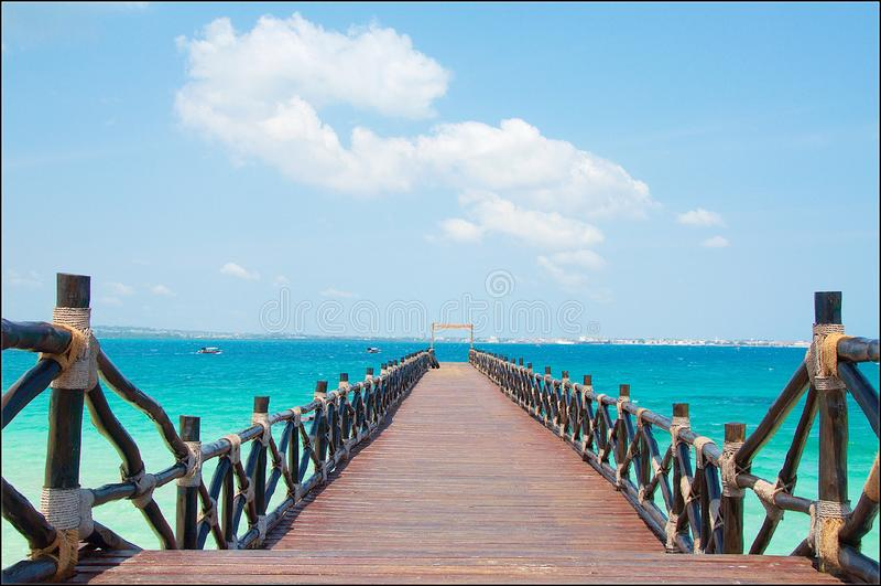 Decorative jetty and aquamarine sea stock image