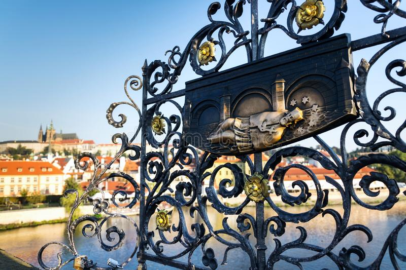 Decorative lattice with John of Nepomuk bronze statue on Charles Bridge, Prague, Czech Republic, sunny day. Clear sky royalty free stock photos