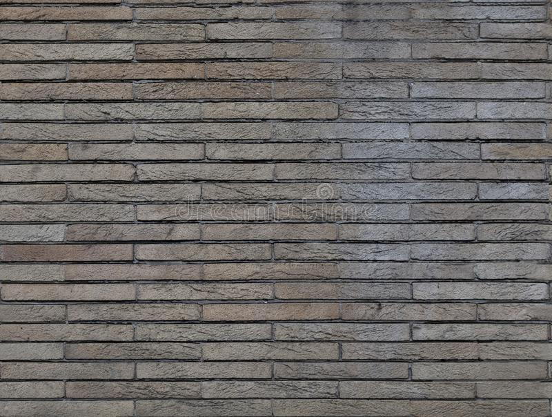 Decorative tiles imitating natural stone.Texture or background. Decorative lining on the wall imitating natural stone stock image