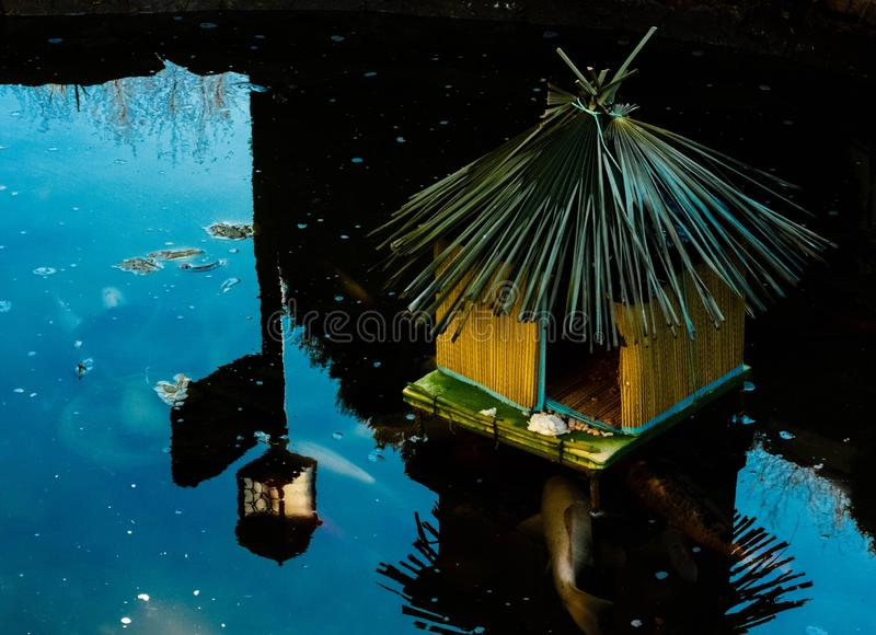 A decorative little hut on water stock photography