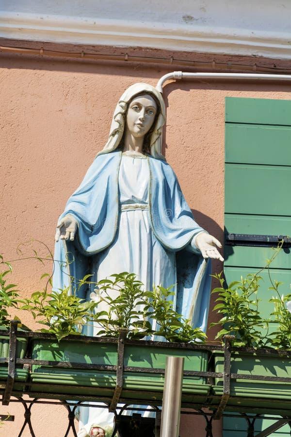 Decorative Mary statue on a balcony royalty free stock photography