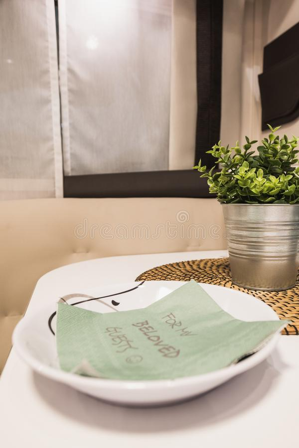 Decorative message on a green serviette inside a caravan. Switzerland stock photos