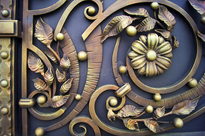 Decorative metal gate with wrought iron flowers stock image