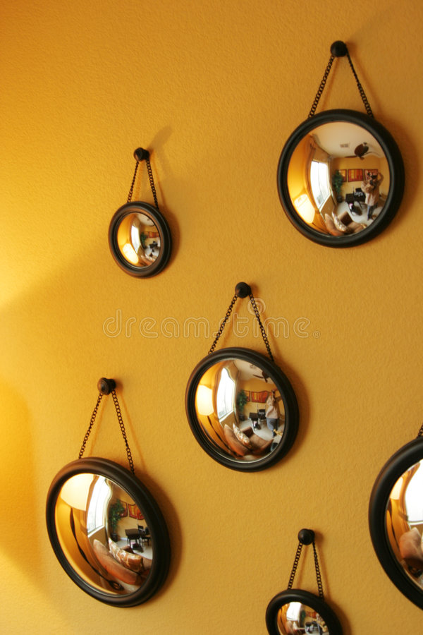 Decorative mirrors on the wall stock images