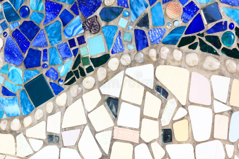 Decorative Mosaic of White and Blue Tiles. Decorative Mosaic pattern of Broken Tiles and decorative glass stones royalty free stock images