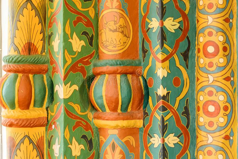 Decorative multi-colored wooden finish at the entrance to the old Orthodox Church. stock images