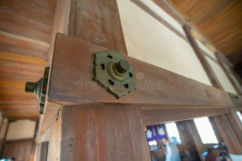 Decorative nails that bind the pine wood together inside of Himeji Castle, Japan. stock images