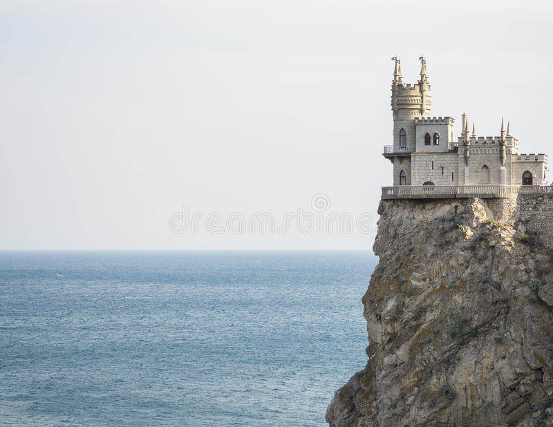The decorative Neo-Gothic castle Swallow& x27;s Nest. On the rock over the Black Sea. Gaspra. Crimea stock images