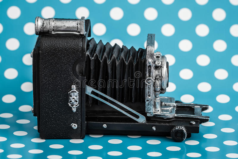 Download Decorative Old Antique Cameras On Blue Background Stock Photo - Image: 83709724