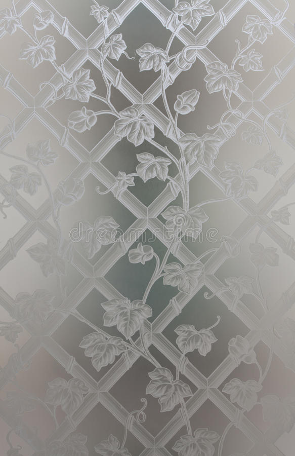 Decorative opaque glass with drawn flowers endraved stock photo