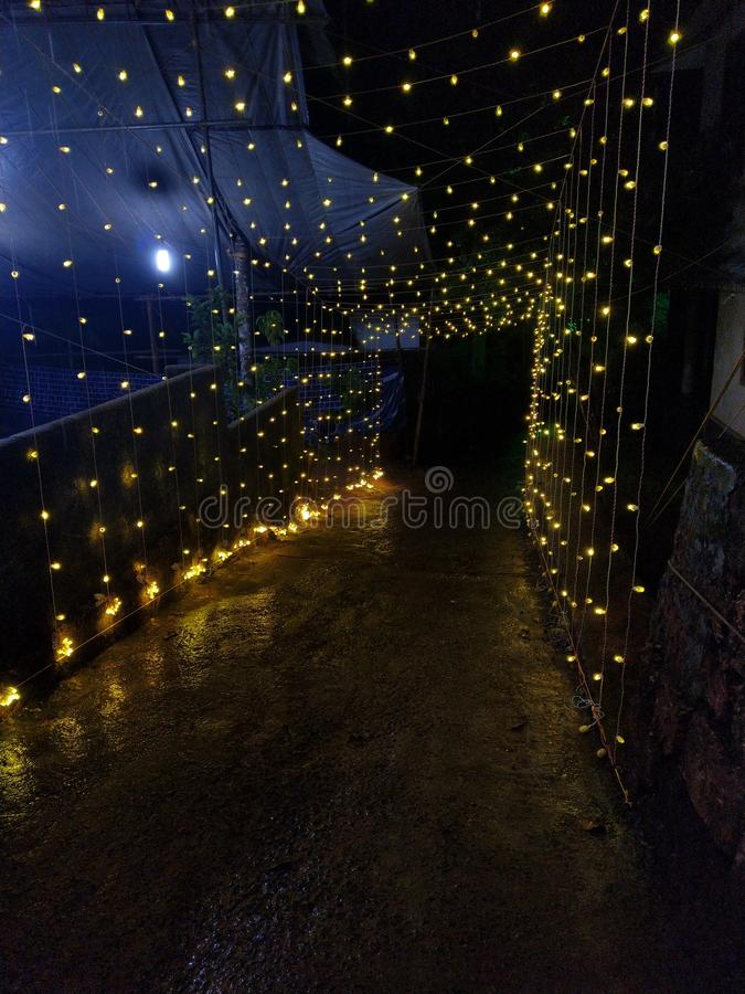 Decorative outdoor lights hanging at night time stock image