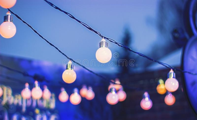 Decorative outdoor string lights hanging at night time stock image download decorative outdoor string lights hanging at night time stock image image of focused aloadofball Gallery