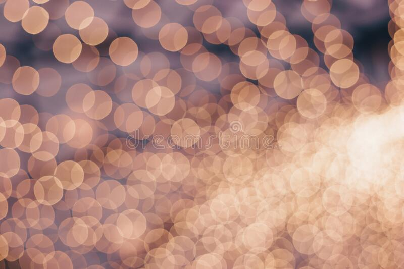 Decorative outdoor string lights at night time, Defocused Background, night city life backdrop, party time with Yellow bokeh balls royalty free stock photography