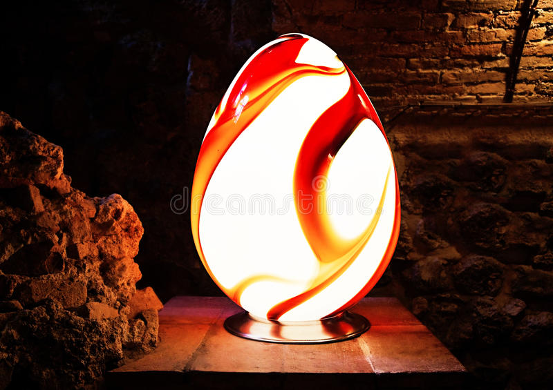 Decorative oval lamp in the form of an egg. Photo of Decorative oval lamp in the form of an egg stock image