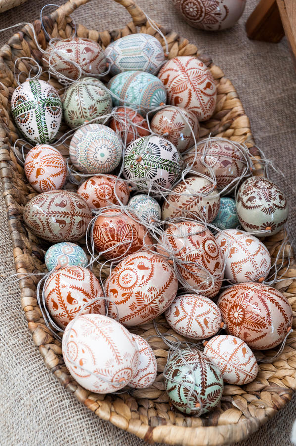 Painted easter eggs. Decorative painted easter eggs in a wicker basket for sale at crafts market stock photo