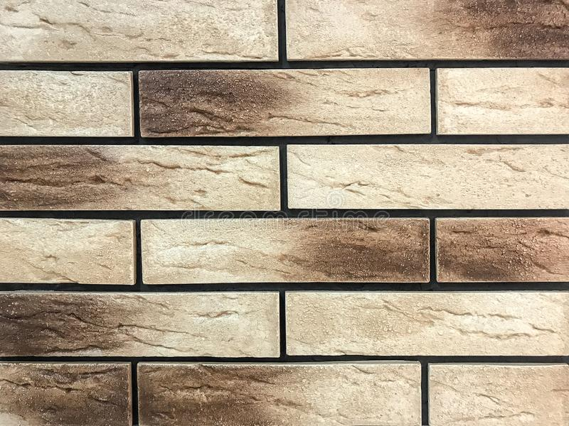 Decorative panel in the form of a beige and brown old brick royalty free stock photography