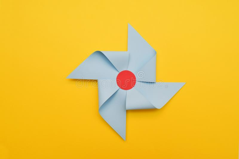 Decorative Paper Winde Vane, Yelow Background. Colorful Summer Concept. stock photography