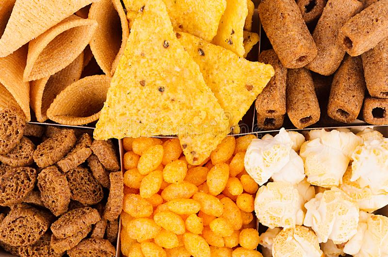 Decorative pattern of crunchy spicy snacks, top view, closeup. Fast food background. stock photo