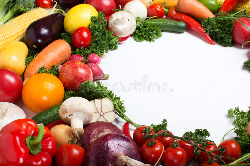Decorative pattern of fresh vegetables on white background stock images
