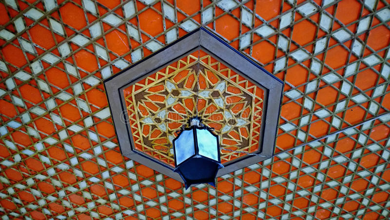 Decorative pattern-ornament on the ceiling and the lamp in the Khan`s Palace in Bakhchisarai.  stock image