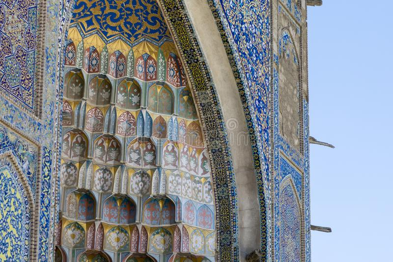 Decorative patterns and architectural details at the main entrance of Abdullaziz Khan madrasah in Bukhara, Uzbekistan stock images