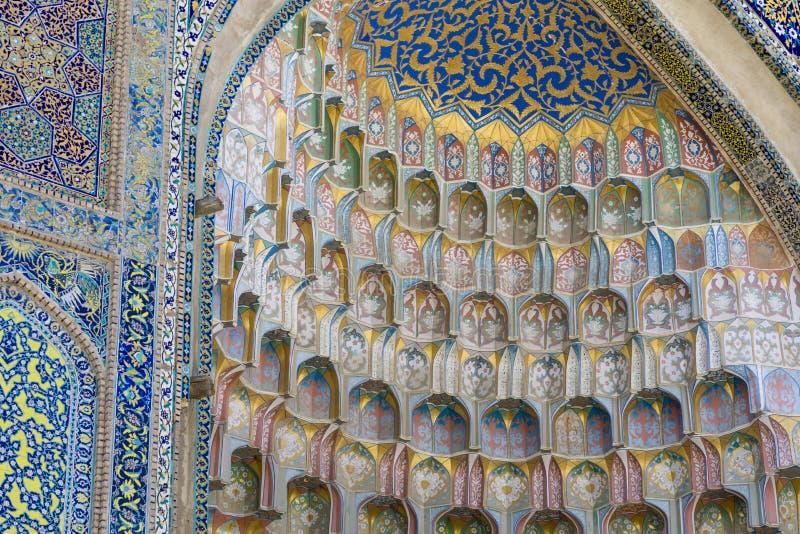 Decorative patterns and architectural details at the main entrance of Abdullaziz Khan madrasah in Bukhara, Uzbekistan stock photography