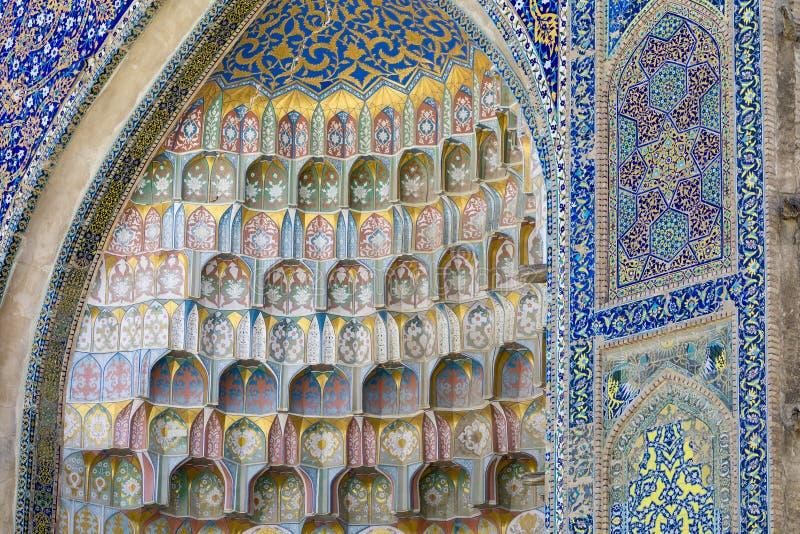 Decorative patterns and architectural details at the main entrance of Abdullaziz Khan madrasah in Bukhara, Uzbekistan royalty free stock image