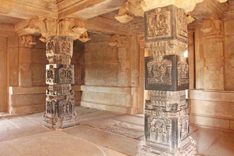 Decorative pillars from black basalt in mandappa or Hall. Hazara Rama Temple Hampi, Karnataka. Stone carving ancient. Indian God stock image