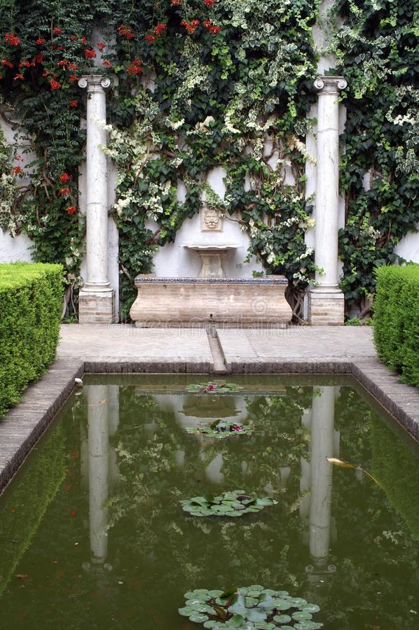 Decorative pond in the Spanish castle in Seville Spain royalty free stock photography