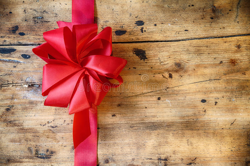 Decorative Red Bow On Rustic Wood Background Stock Photos