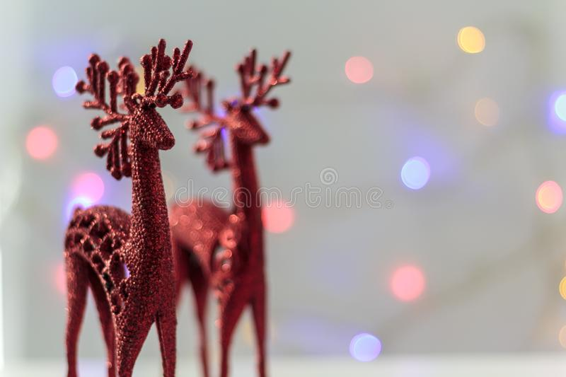 Decorative Red reindeer with christmas lights on the background.  stock photography