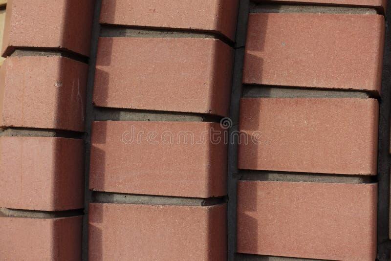 Decorative brickwork made of reddish orange bricks. Decorative relief brickwork made of reddish orange bricks stock photo