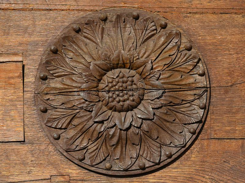 Decorative rosette on wooden door stock photos