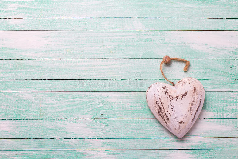 Download Decorative Rustic Heart On Turquoise Painted Wooden Background Stock Image