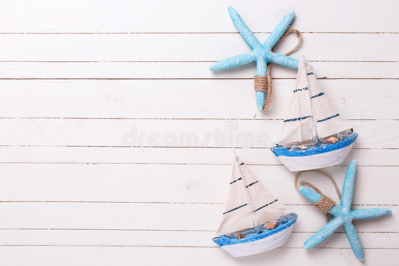 Decorative sailing boats and marine items on wooden background. stock image