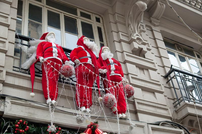 Decorative Santa Clauses on the balcony of the house.  royalty free stock images