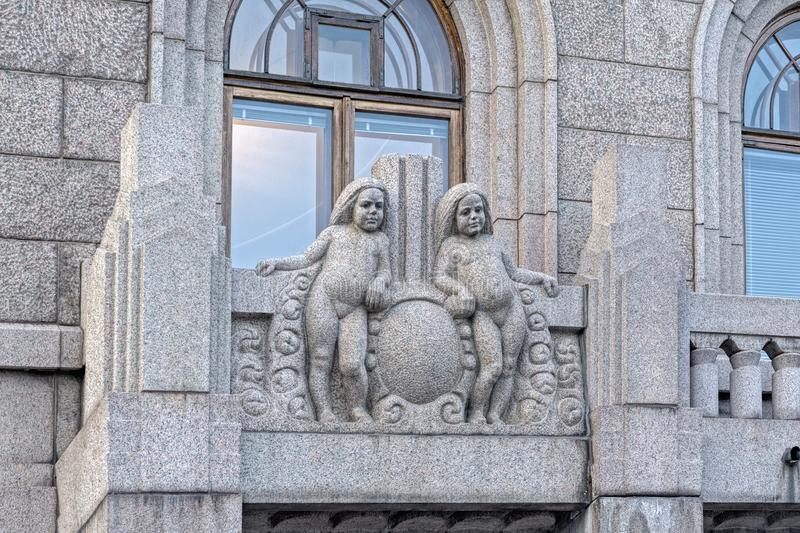 Decorative sculptural elements on the facade. HELSINKI, FINLAND - February 24, 2017: Decorative sculptural elements on the facade of building of the insurance royalty free stock photo