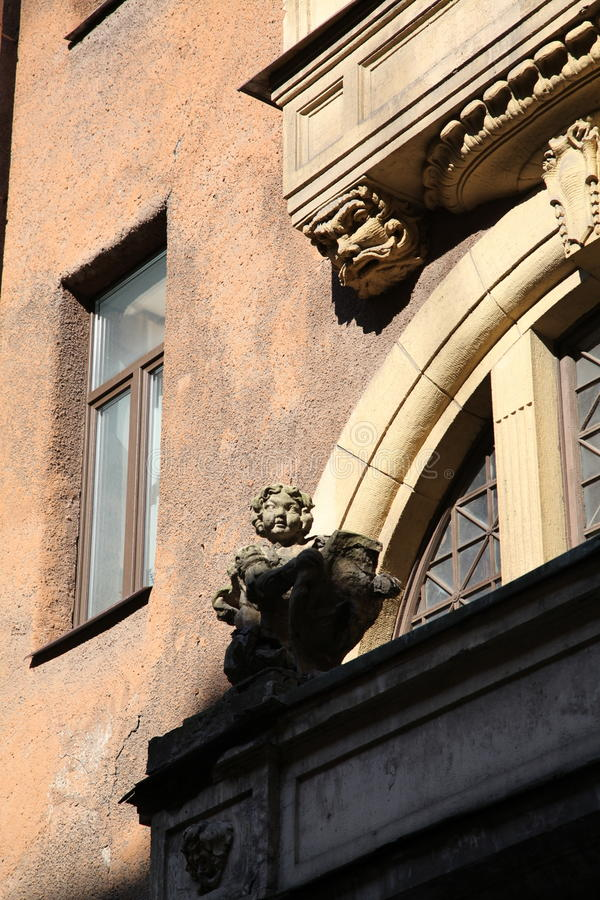 Decorative sculptural elements on the facade of the old building. Sunny day summer 2015 on Pestel street in St. Petersburg, Russia, Northern Europe stock photography