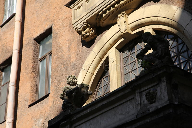 Decorative sculptural elements on the facade of the old building. Sunny day summer 2015 on Pestel street in St. Petersburg, Russia, Northern Europe royalty free stock photography