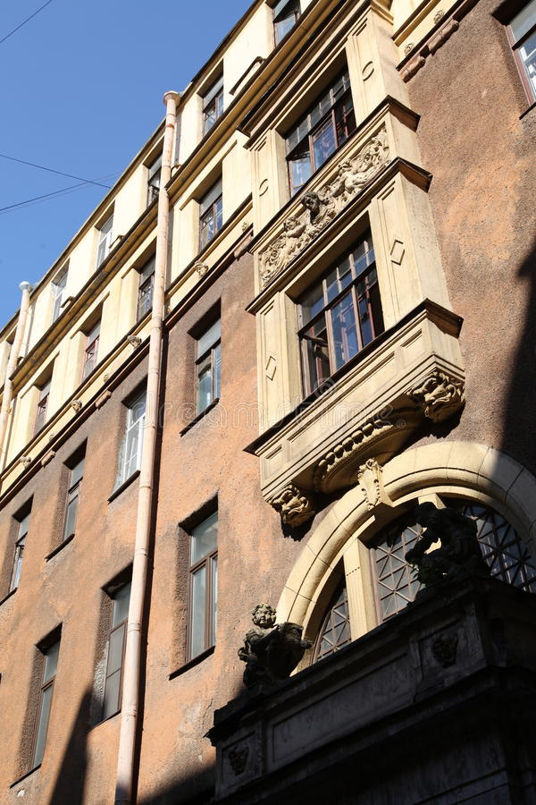 Decorative sculptural elements on the facade of the old building. Sunny day summer 2015 on Pestel street in St. Petersburg, Russia, Northern Europe stock images