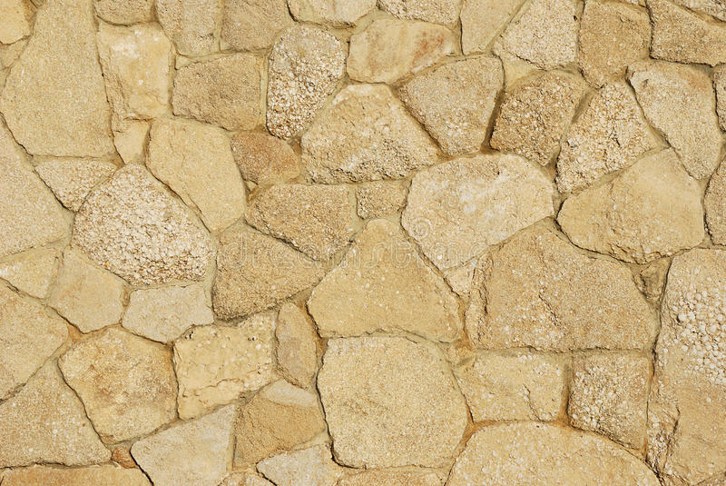 Decorative sidewalk paved with natural sandstone. Decorative texture of sidewalk paved with natural sandstone with varied sand tints royalty free stock photos
