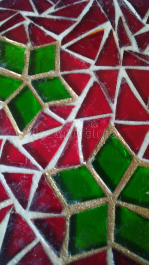 Decorative stained glass with red and green Christmas motif. stock image