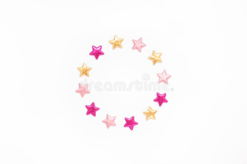 Decorative stars round wreath frame. Holiday composition. New Year or Christmas pattern flat lay top view Xmas holiday celebration decorative color stars round royalty free stock images
