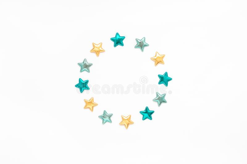 Decorative stars round wreath frame. Holiday composition. New Year or Christmas pattern flat lay top view Xmas holiday celebration decorative color stars round stock photo