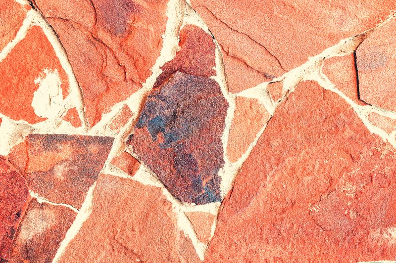 Decorative stone background, texture of a stone for decorating of facades of buildings and internal walls. stock image