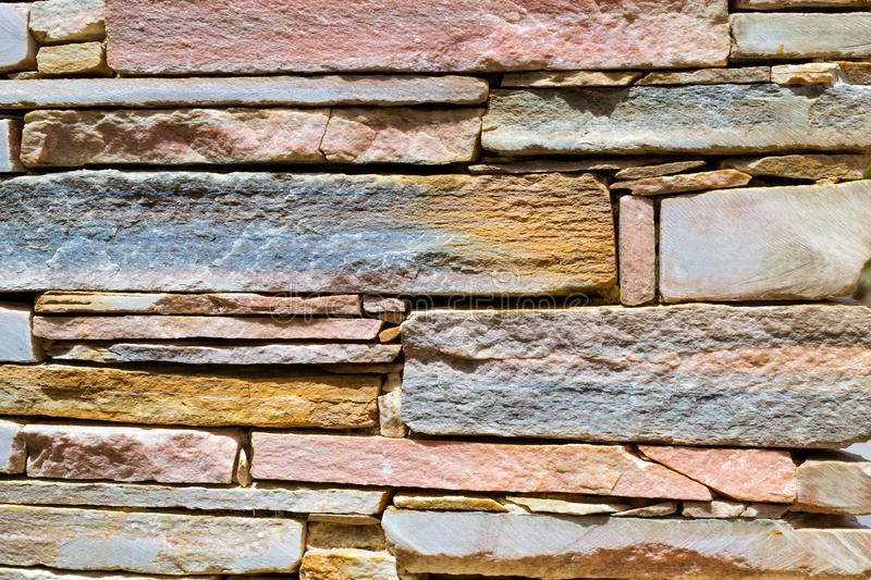 Decorative stone wall, Cobble texture with cracks. Decorative stone wall, pieces of rock bonded with cement. Cobble texture with cracks. Mountain of castle San stock photography