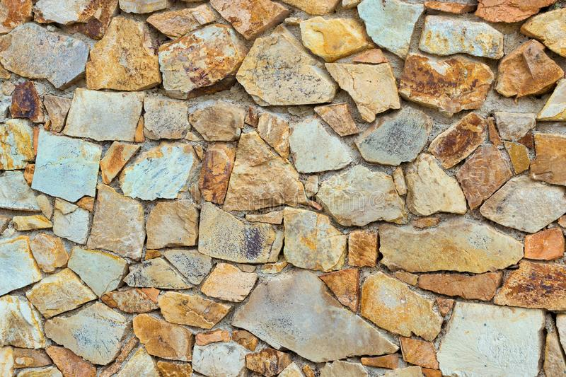 Decorative stone wall, Cobble texture with cracks. Decorative stone wall, pieces of rock bonded with cement. Cobble texture with cracks. Mountain of castle San royalty free stock photography