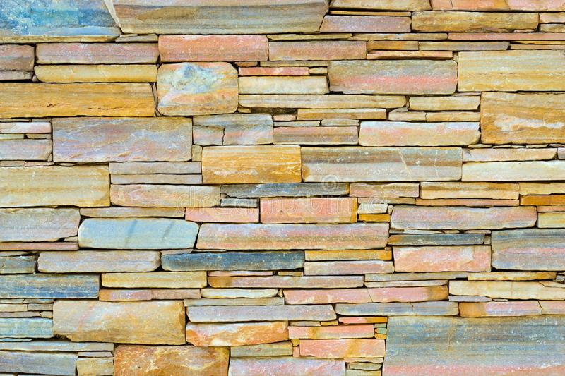 Decorative stone wall, Cobble texture with cracks. Decorative stone wall, pieces of rock bonded with cement. Cobble texture with cracks. Mountain of castle San royalty free stock images