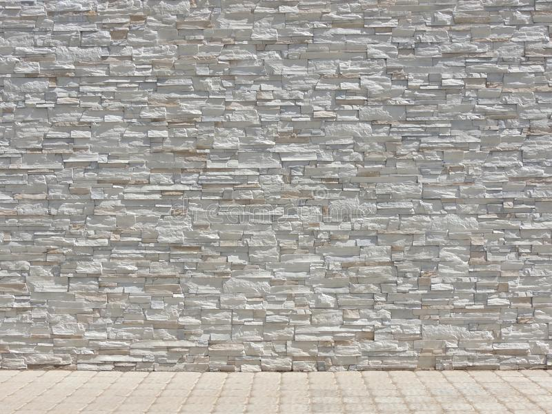 Decorative stone wall and tiled floor interior texture. stock photography