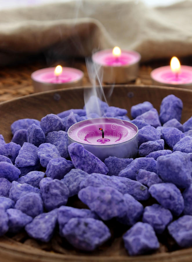 Decorative stones and candles royalty free stock photo
